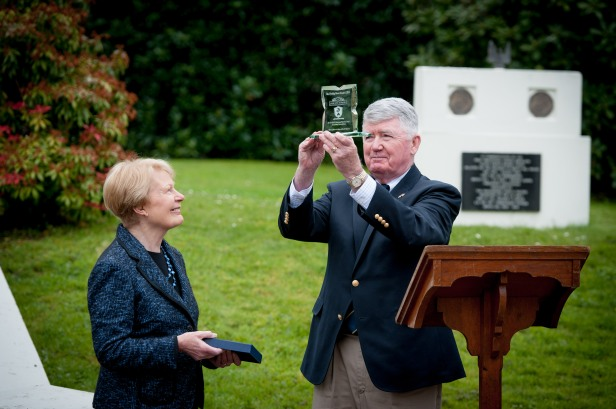 Col Dave Wall USMC Retd, inspects the 2015 Paddy Hone Award presented by Mrs Pat Hume to Col Wall on behalf of Military Historical Tours of Woodbridge, VA. Mrs Hume is a Patron of the Beech Hill US Navy & Marine Corps Association which annually presents an award to an individual or organisation which has made a significant contribution to preserving the story the US Navy and Marine Corps in Derry during the Second World War. Military Historical Tours are working with the Base One Museum at the Beech Hill and with Tourism Ireland to develop an annual visit to Derry to look at the history of the WWII US Naval Base. PHOTOCREDIT Stephen Latimer